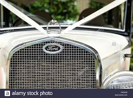 Vintage Ford Truck Grill - the front grill of a classic old ford car clearly showing the ford