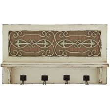 vintage rustic wall mounted coat hooks from white framing window