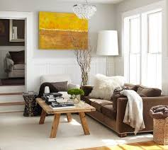 Yellow Walls Living Room by Yellow Sofa With Tan Walls Brown Leather Sofa And Natural Wooden