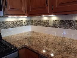 kitchens with mosaic tiles as backsplash white glass random strips backsplash tile mosaic kitchen