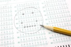 a smiley face is filled out on a bubble test sheet with a number