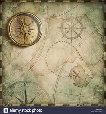 World Treasure Map by Aged Brass Antique Nautical Compass And Old Treasure Map Stock