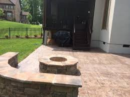 Retaining Wall Patio Rustic Stamped Concrete Patio And Firepit With Retaining Wall In