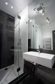 Modern Apartment Bathroom - open layout apartment in warsaw exhibiting fresh industrial design