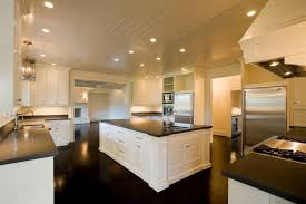 white kitchen cabinets with brown floors the glistening wood floor of this kitchen brings out