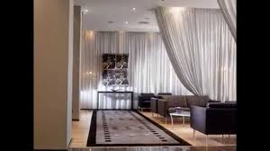 should drapes touch the floor ceiling mount curtain rod lowes track walmart room divider umbra