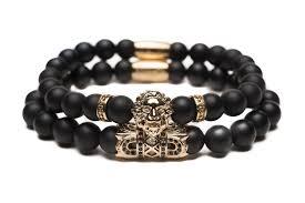 black bracelet with gold images Gold lion stack zorrata jpg