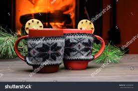 cup christmas ornament near fireplace mug stock photo 520055848