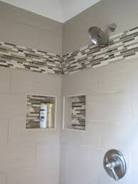 linen tile with glass linear mosaics to accent the shower space