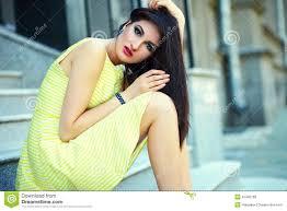stylish woman in casual yellow dress stock photo image