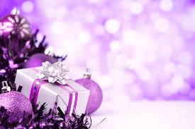 purple christmas scene with baubles and gift stock photo image