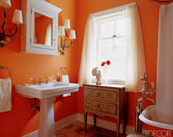 vintage style bathroom with tangerine orange walls bathroom