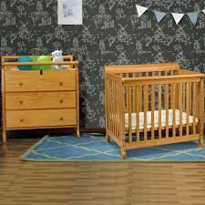 Davinci Emily Mini Crib by Bedroom Stunning Brown Wood Crib Changer Combo With Awesome Dolls