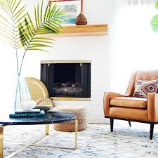 white rich fireplace caramel leather reading chair boho meets