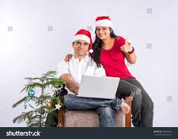 young indian couple red santa hat stock photo 343658441 shutterstock
