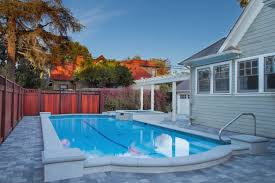 ideas modern pools design with stone flooring and wooden fence