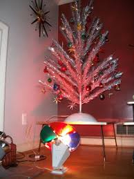 an aluminum tree illuminated by a revolving color wheel