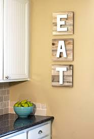 eat sign on reclaimed wood with dimensional painted metallic