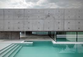 outdoor pool concrete and glass home in urgnano italy