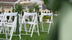 Wooden Wedding Chairs Rows Of Formal White Wooden Wedding Chairs Set Up For A Wedding Or