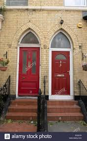 two red front doors arched church like elegant stock photo
