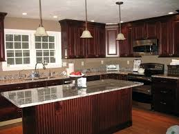 cherry kitchen cabinets with granite countertops quartz backsplash