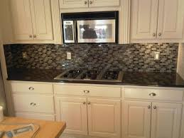 kitchen backsplash tile with dark cabinets stainless steel kitchen