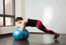 Sitting On A Medicine Ball At Desk Abs Workout Best Stability Ball Moves For Your Core Greatist