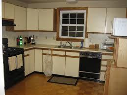kitchen cabinets wall mounted countertops backsplash ceiling molding ideas cream oak wood