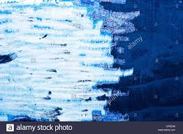grunge painted wall textures in blue color with paint scraped