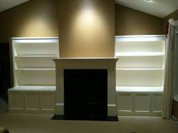 custom made build in a cabinets shelving fireplace mantel surround