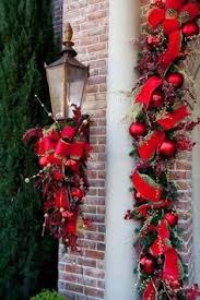 christmas swags for outdoor lights great idea for decorating a porch sconce but it needs some white or