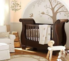 baby nursery brown lacquered wood baby crib with chandelier with