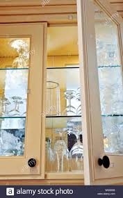 glass shelf between kitchen cabinets kitchen cabinet up with glass shelves and glasses