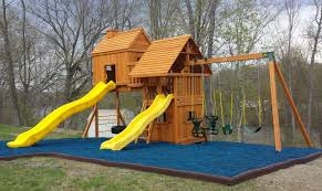 blue rubber mulch looks great against cedar swing sets