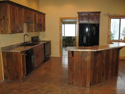 curved brown wood kitchen island with granute top connected by