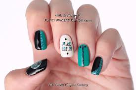 black and turquoise gelish nails with konad stamping funky