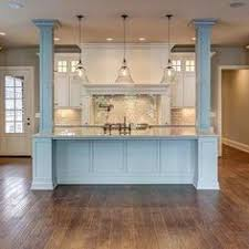 kitchen island with columns a white kitchen is timeless open kitchens beams and columns
