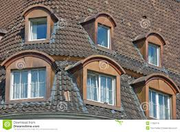 bonneted dormer windows and tiled roof royalty free stock image