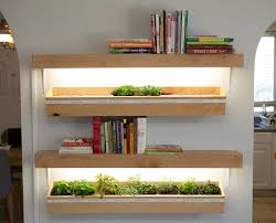 i added some bookshelves grow lights to my indoor planter boxes