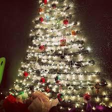 best way to hang christmas lights on wall diy christmas trees perfect for small spaces hanging christmas