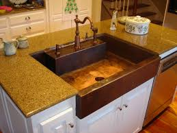 copper kitchen sink a container of water in the container and
