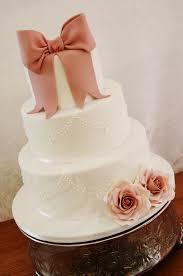 wedding cake newcastle three tiered white wedding cake with dusty fondant ribbon
