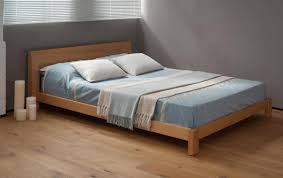 beautiful low bed soft blue color bedcover wooden modern floor