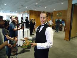 waiters serving odeurves to niff 2014 guests film directors