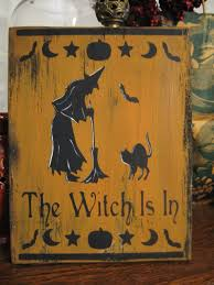 primitive halloween sign the witch is in black cat bat spooky