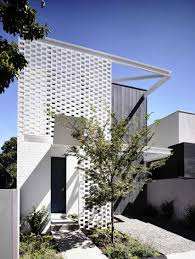 perforated brick entrance screen defining fairbairn road house in