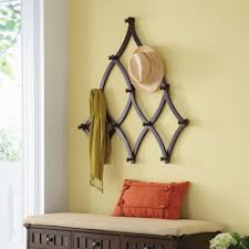 with 13 sturdy hanging hooks this expandable coat rack has ample