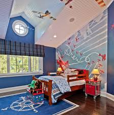 bedroom blue walls with roman shades and wall murals also blue walls with roman shades and wall murals also beadboard ceiling and hanging airplane with kids bed and kids bedding plus area rug and hardwood flooring