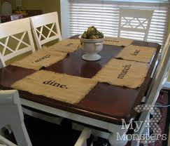 my 3 monsters day 25 stenciled burlap placemats i was too lazy to put the leaf in the table and pull in two extra chairs just to stage a picture apparently i couldn t be bothered